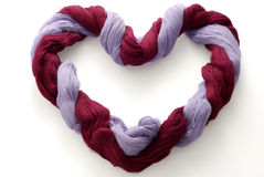 Bicolor skein of wool in shape of heart Royalty Free Stock Photos