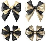 Bicolour satin bows isolated on white. Golden and black bicolour realistic beautiful satin bows for gift isolated on white. Vector illustration Royalty Free Stock Photo