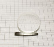 Biconcave optical glass lens on the square background Royalty Free Stock Photo