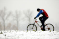 Bicycle 01. The image shows spirit, strength and determination to ride a bicycle even if the conditions make it harder. May be used also on other topics where Stock Photos