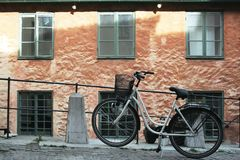 Bicycle. Near an old building in Visby Stock Photo