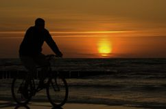 Bicycle. On the baltic beach - sunset stock images