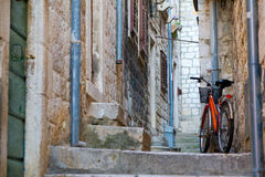 Bicycle. Narrow street in the old residential district of Hvar, Croatia Royalty Free Stock Photography