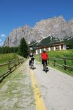 By bicycle. Doing sport in the beautiful context of Cortina in Italy Royalty Free Stock Images