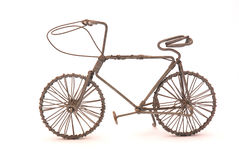 Bicycle. An old rusty handmade bicycle made out of wire isolated on white studio background. This bike is an African art holiday souvenir from South Africa Royalty Free Stock Photos