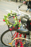 Bicycle. Woman bicycle with flowers at north metro station at Copenhagen Stock Photo