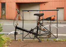 Bicycle abandoned on the road, dismounted wheels. Stock Images