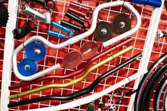 Bicycle accessories on stand in shop Stock Image