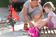 After bicycle accident. Child after bicycle accident with mom royalty free stock photo