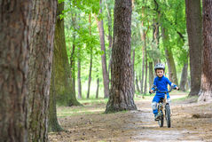 Bicycle accident. Kids safety concept. Boy transporting his bike to repair place. Stock Image