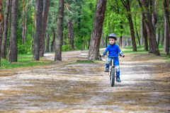 Bicycle accident. Kids safety concept. Boy transporting his bike to repair place. Stock Images