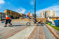 Bicycle acrobatics in the Manege square of Moscow Stock Photo