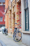 Bicycle against brick wall in Brugge Royalty Free Stock Photo