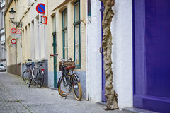 Bicycle against brick wall in Brugge Stock Photo
