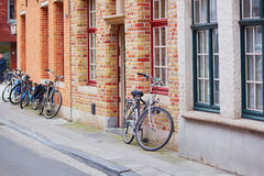 Bicycle against brick wall in Brugge Royalty Free Stock Photography