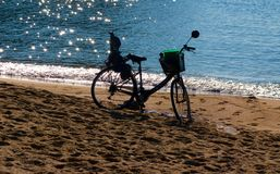 A bicycle against the light. A bicycle against the light, on the beach invited to tranquility Stock Photos