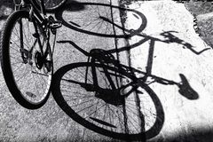 Bicycle against shadow Royalty Free Stock Photo