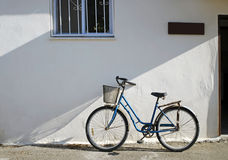 Bicycle against Stucco Building royalty free stock image