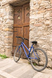 Bicycle against the traditional wall architecture of Nafplio in Greece. Royalty Free Stock Images