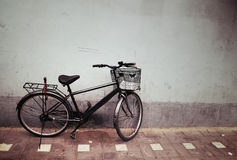 Bicycle against a Wall Royalty Free Stock Photography