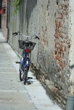 Bicycle against the wall Stock Photo