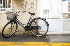 Bicycle against wall in japan Stock Photo