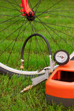 Bicycle and air compressor Stock Images