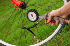 Bicycle and air compressor Stock Photography