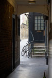Bicycle in alley Royalty Free Stock Images