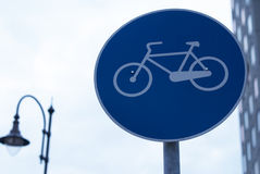 Bicycle alleys sign. Blue bicycle alleys sign in urban background Royalty Free Stock Images