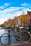 Bicycle in amsterdam. With canal and sky Royalty Free Stock Photography