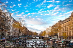 Bicycle in amsterdam. With canal and sky Stock Image