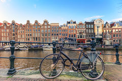 Bicycle at Amsterdam. Bicycle against the house over the canal of Amsterdam, Holland Royalty Free Stock Image