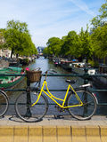 Bicycle in Amsterdam Canal Royalty Free Stock Photo