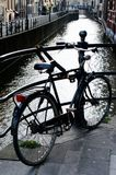 Bicycle in Amsterdam, Holland. Bicycle left on canal overwalk in Amsterdam, Holland royalty free stock photo