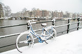 Bicycle in Amsterdam Netherlands in winter. Bicycle in Amsterdam the Netherlands covered in snow Royalty Free Stock Photo