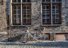 A bicycle on ancient street in Bruges, Belgium stock photography