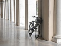 Bicycle in arcade Stock Images
