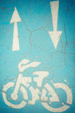Bicycle and arrows sign Stock Photos