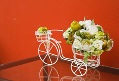 Bicycle with artificial flower Royalty Free Stock Photo