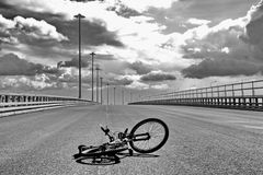 Bicycle on asphalt. Empty highway and bicycle on asphalt Royalty Free Stock Image