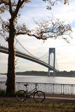 Bicycle in the autumn park. Close to the Verrazano-Narrows Bridge , The largest and longest bridge in New York City stock photos