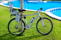 Bicycle with baby seat in grass pool outdoor Stock Photography