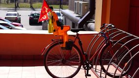Bicycle with baby seat parked stock video footage