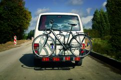 Bicycle on the back of a car Stock Images