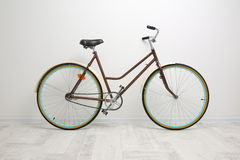 Bicycle on the background of white walls Stock Photography