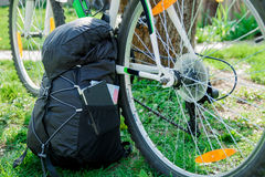 Bicycle and Backpack with tourist equipment Stock Image