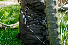 Bicycle and Backpack with tourist equipment Stock Photo