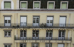 Bicycle on Balcony of Apartment Block Stock Photography