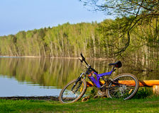 Bicycle on the bank Royalty Free Stock Photos